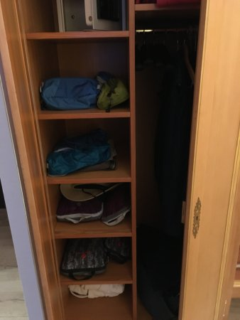 Le Rapp Hotel: The armoire with shelf storage. It was great to be able to unpack for our three night stay,
