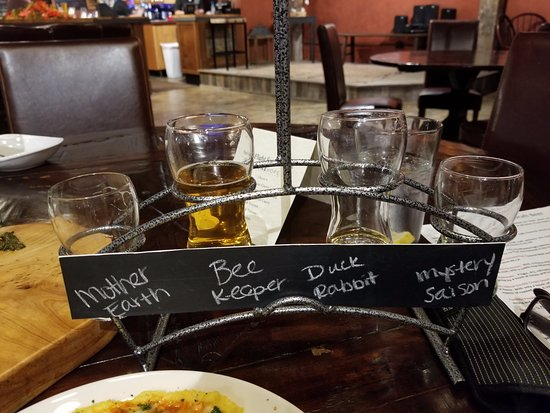 Lexington, NC: Flight of beers. Names written in chalk. How clever!