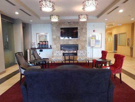 Kulpsville, PA: Sit by the fire and socialize with family in our lobby!