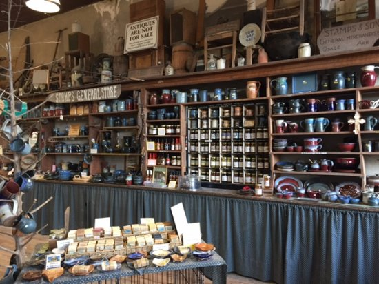 Alpena, AR: Pottery display on the shelves of the old general store