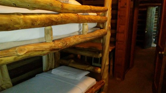 Grand Canyon Lodge - North Rim: Bunk bed across from futon, bathroom is in the middle. Door open at far end is the main entry