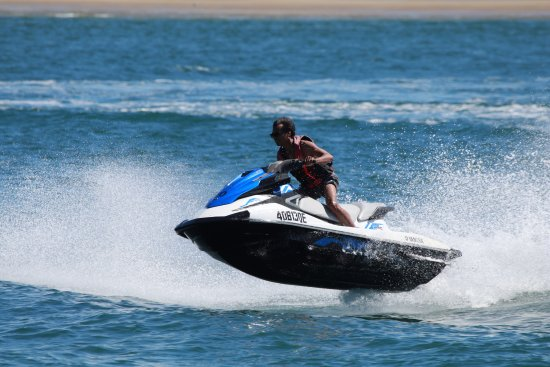 Main Beach, Australia: Getting some airborne action on our jetski circuit at Gold Coast Watersports