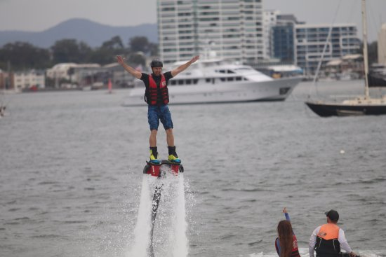 Main Beach, Australia: Thumbs up for this champion flyboarder at Gold Coast Watersports
