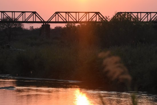 Skukuza Rest Camp: The view from our cottage of the old colonial railway bridge to our right