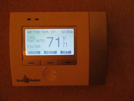 Dedham, MA: Thermostat. Fan always on auto. What does that lower button do? Time was set wrong.