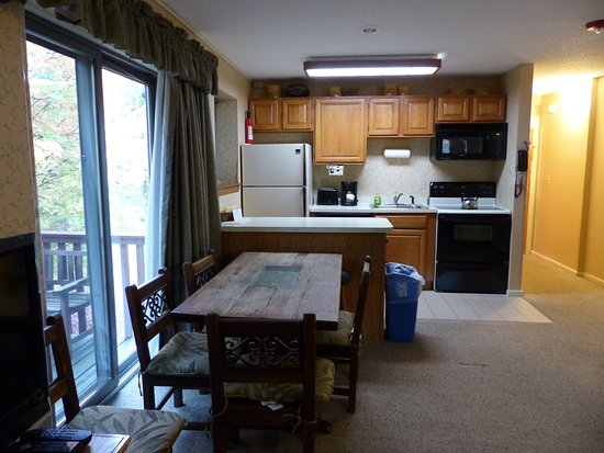 Bartlett, NH: Kitchen and dining area in studio -- Attitash Mountain Village