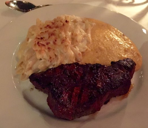 Embers Wood Grill: Twelve-ounce New York strip, mac and four cheeses, and spicy prosciutto and cheese grits.
