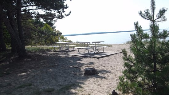 Picnic tables outside the Information Kiosk in Batchawana Bay Park  - (Day Use Only)