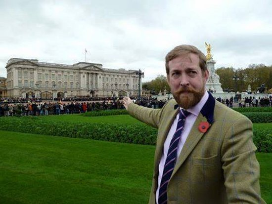 London, UK: One of our guides in front of Buckingham Palace