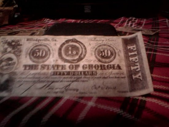 Country Inn & Suites By Carlson, Winchester: Confederate money from the gift shop.