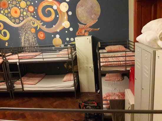 Art Hole: the right side of the 10 bed room with the storage for luggage