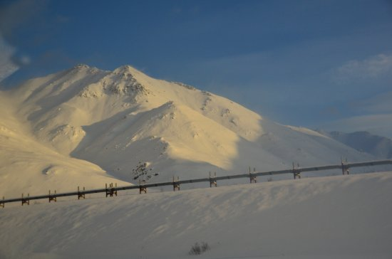 Coldfoot, AK: Oil pipeline and Brooks Range mountain scenery.
