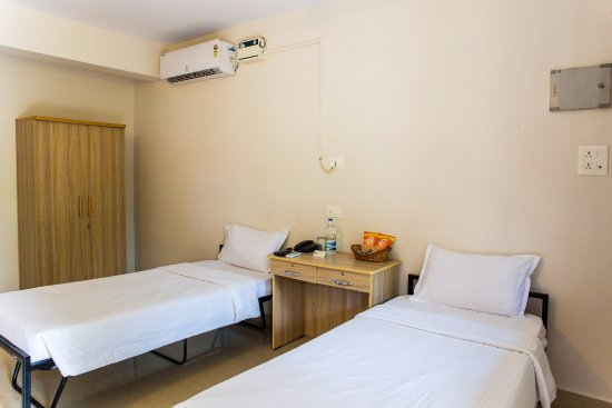 Carmona, India: Twin Room, Bed setup for non-couples