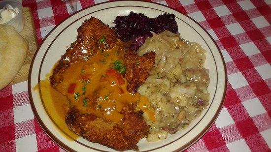 Hudson, WI: Breaded pork cutlet with paprika sauce, warm potato salad, white and red wine-braised cabbage