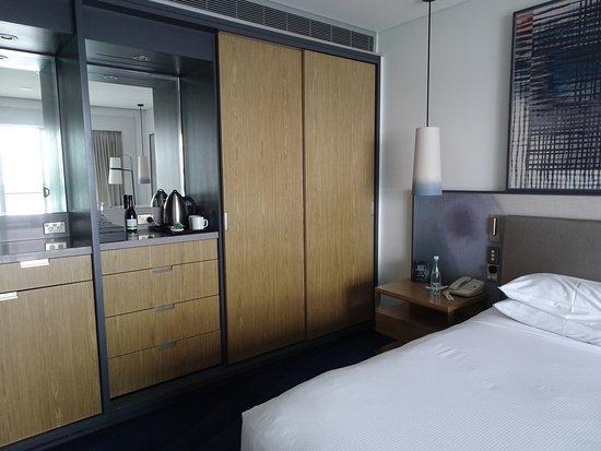 Hilton Auckland: Compact Closet, Dresser, Bar Etc. Along Side Of Our Room