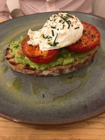 Thame, UK: Poached eggs and avocados on sourdough toast