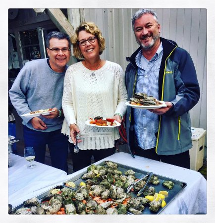 Bald Head Island, NC: Guests enjoying their time at the Maritime Market's Oyster Roast