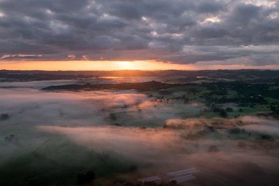 Tyagarah, Australia: Sunrise over the mist with Byron Bay Ballooning