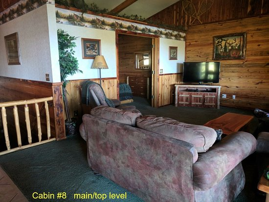 Lake Shore Cabins on Beaver Lake: Cabin #8 Living rm - notice bedroom wall does not go to ceiling. Fireplace to the right of the t