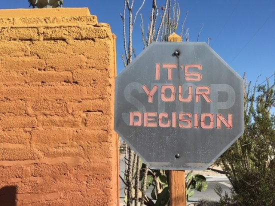 29 Palms Inn: Sign at exit--open to interpretation.