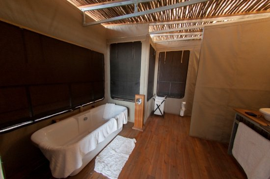Elephant's Eye, Hwange: picture window over tub can also be opened for a private view of the watering hole