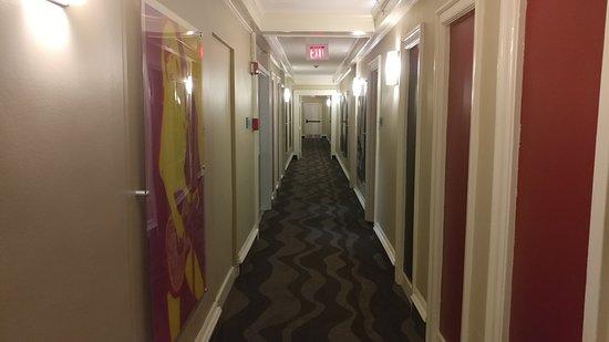Hallway decor dolly parton and john wayne picture of for Hotel hallway decor