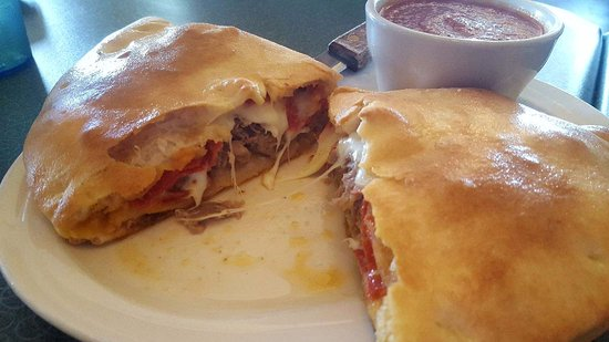 Vince's Restaurant & Pizzeria: Meat Lover's Calzone stuffed full of Italian Beef, Sausage, Ground Beef and Pepperoni