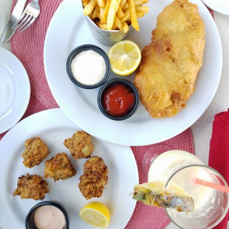 Las Brisas Restaurant: We shared conch fritter appetizers, fish and chips entree, and a pina colada.