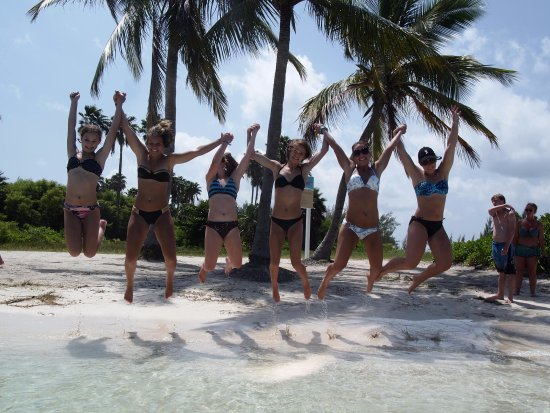 George Town, Grand Cayman: Miami Dolphins Cheerleaders visiting our beautiful beach!