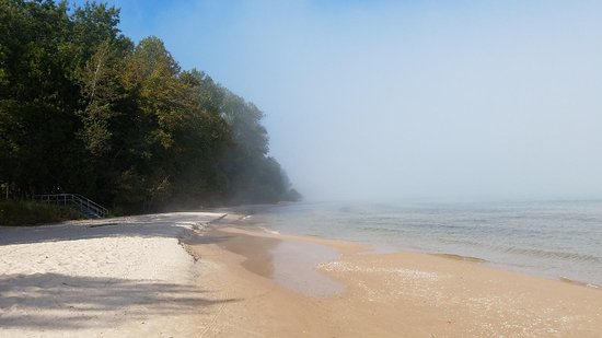 Belgium, WI: A warm, sunny September day with fog over the lake