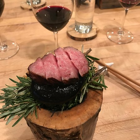De Beque, CO: Sizzling waygu beef cooked on hot rocks, served on smoldering rosemary and thyme