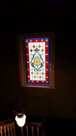 The Anchorage Hotel: Stain glass window on stairs