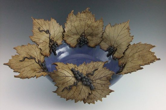 Mount Horeb, WI: Wheel thrown hand built incised grape leaf flared bowl.