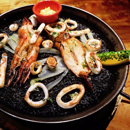 The Paella Negra (squid ink paella) is a crowd favourite!