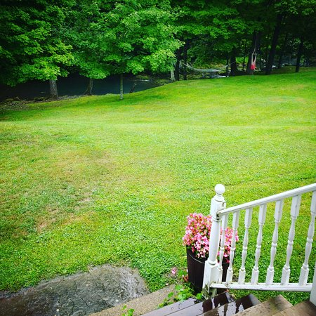 Claverack, NY: The expansive lawn slopes down to the river.