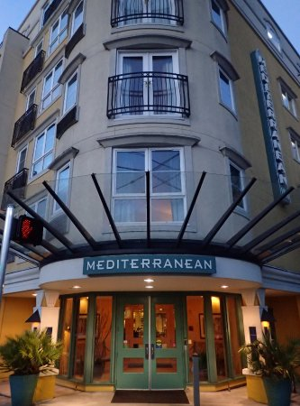 Mediterranean Inn: Early morning view of the hotel from the street.
