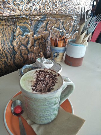 Corelli's: Amazing Green Tea Latte with Almond milk served in a beautiful handmade cup.