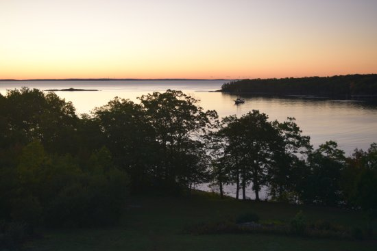 Ledges By the Bay: View of the bay from the room balcony at sunrise. The sailboat arrived during the night.