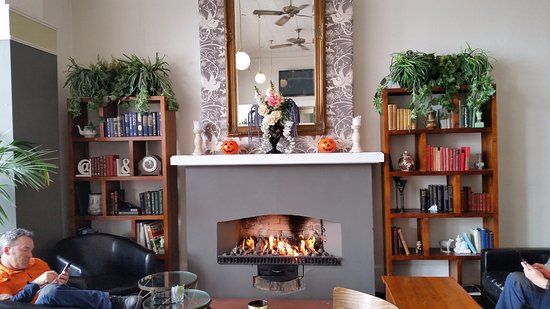 Devonport, New Zealand: Crackling Open Fire with Well Stocked Book Shelves