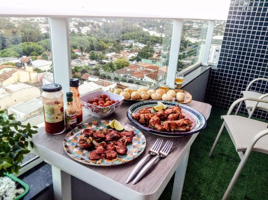Join Jules on her balcony after your private hands-on cooking class in Londrina - Traveling Spoo