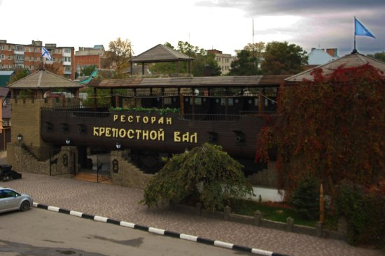 """Azov, Russia: The restaurant """"Krepostnoi Val"""", """"The fort's mound"""". The summer terrace looks like a old ship."""
