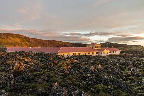 Moss covered lava surrounds Northern Light inn, fall sunset.