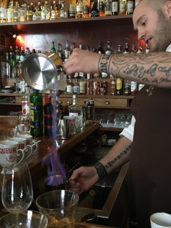 "Prague Food Tour: Talented and knowledgeable mixologist making a ""blue blazer."""