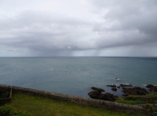 Start Point Lighthouse: Rain at sea