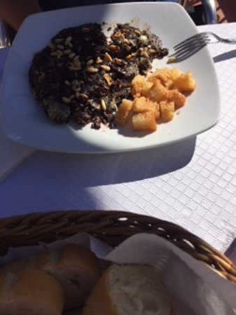Otivar, Spain: Scrambled egg black pudding and pine nuts with croutons