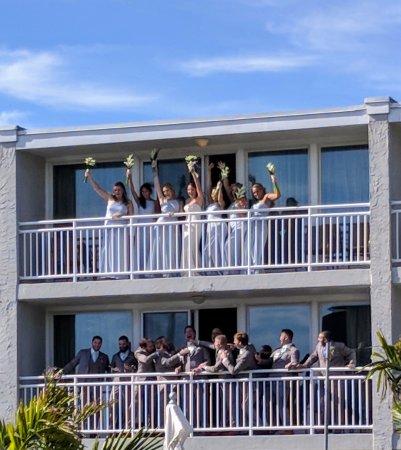 Windrift Resort Hotel: Wedding party on balcony facing pool