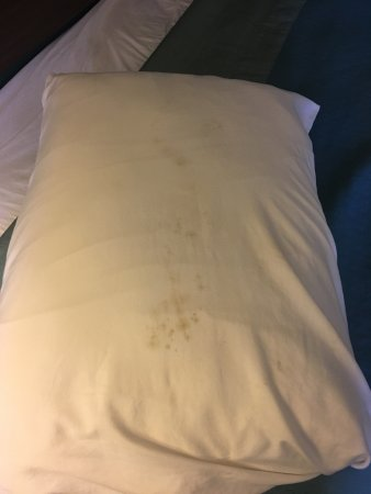 Super 8 Harrisburg Hershey West: Stained pillow on the bed.