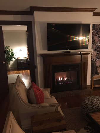 One Of The Two Fireplaces In The Sitting Area Bedroom Through The Door Picture Of The Pillar And Post Inn Spa And Conference Centre Niagara On The Lake Tripadvisor