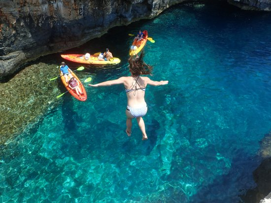 Cliff jumping while exploring the South Side of Vis Island