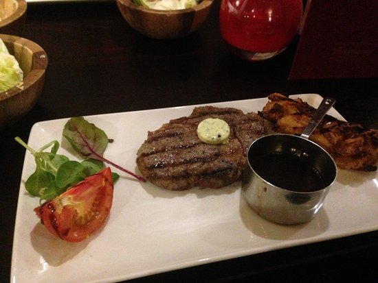 Studley, UK: 50 day aged grain fed 8oz ribeye steak (yum yum) with onion loaf and beef dripping sauce